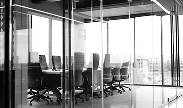 Black and white boardroom encased with glass walls